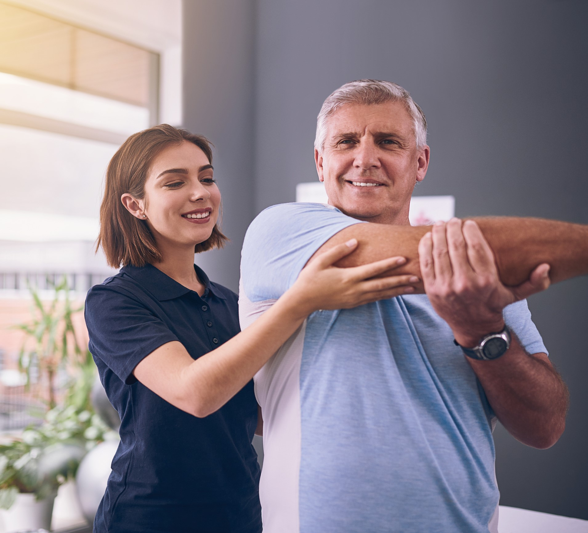 Man stretching his arm during a physiotherapy session