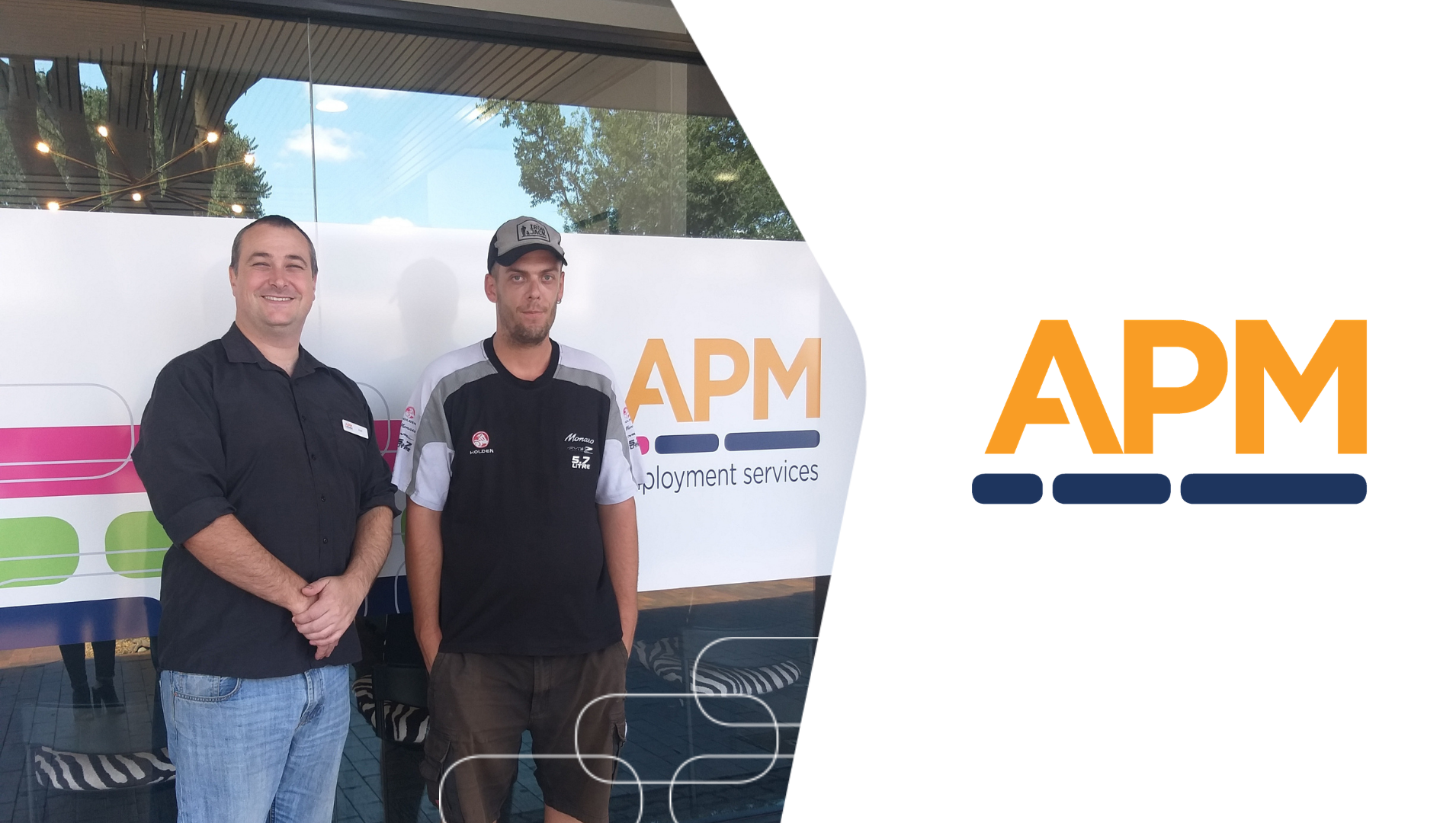 Joel and Tod are pictured together, smiling in front of the APM Dubbo office